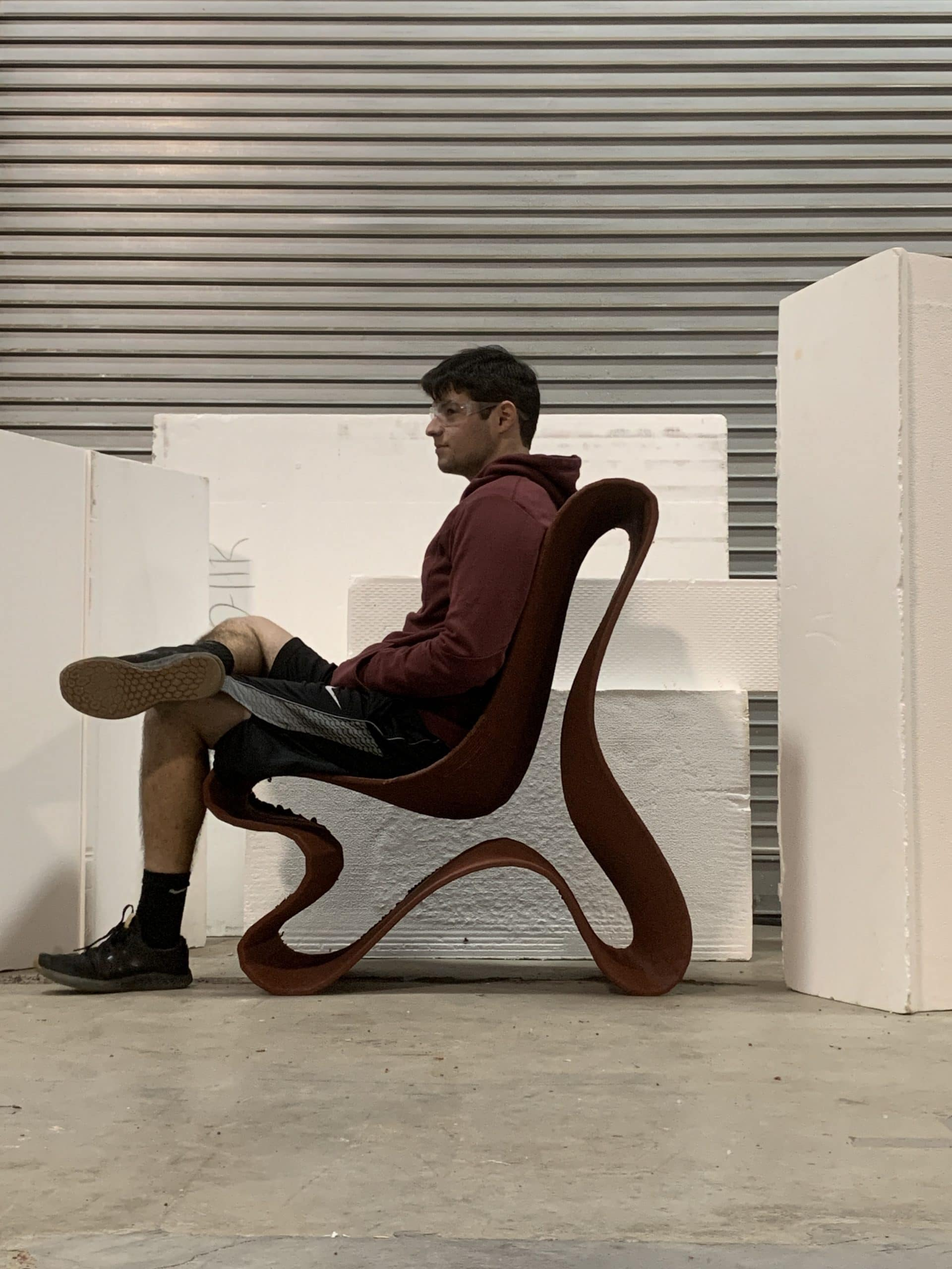 Man sitting on 3D printed outdoor chair designed in Gravity Sketch