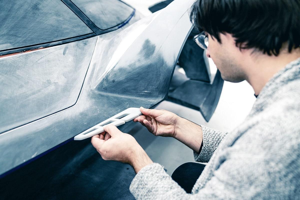 Gravity Sketch - Photo of Automotive designer, Matteo Gentile with 3D print of car