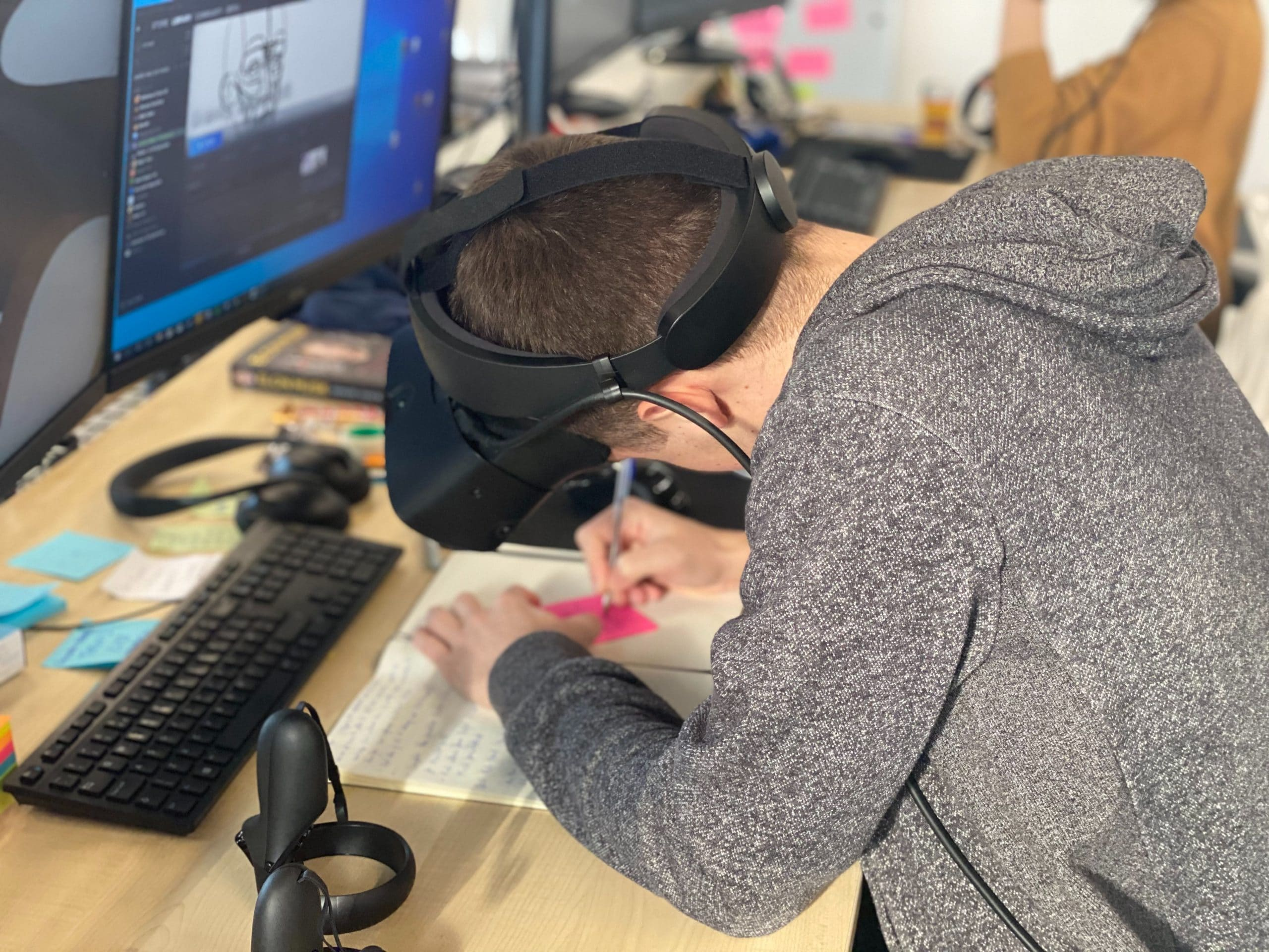 VR being used at the desk by designers at the Gravity Sketch office