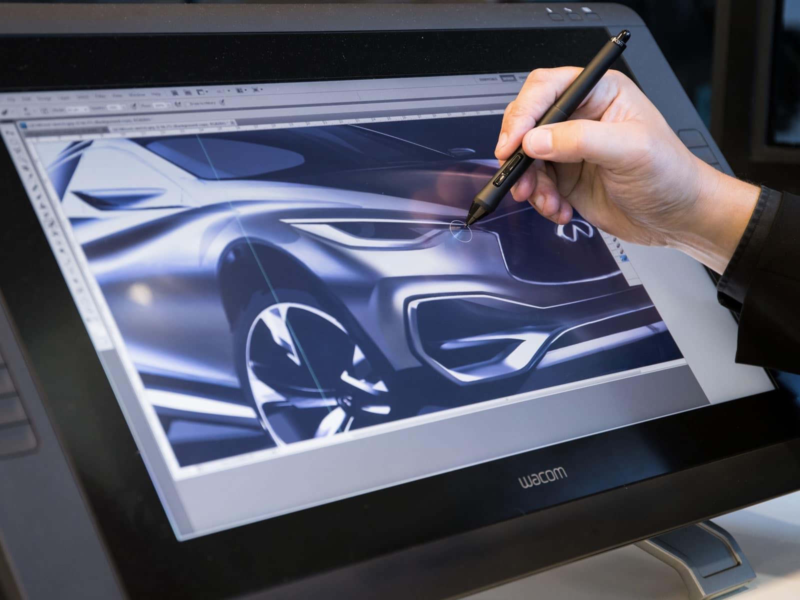 Man designing model of car on Wacom tablet in Gravity Sketch