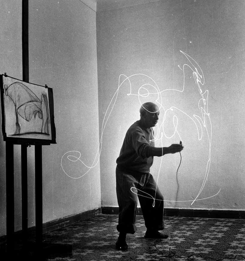 Grayscale image of Pablo Picasso drawing with light for Gjon Milli