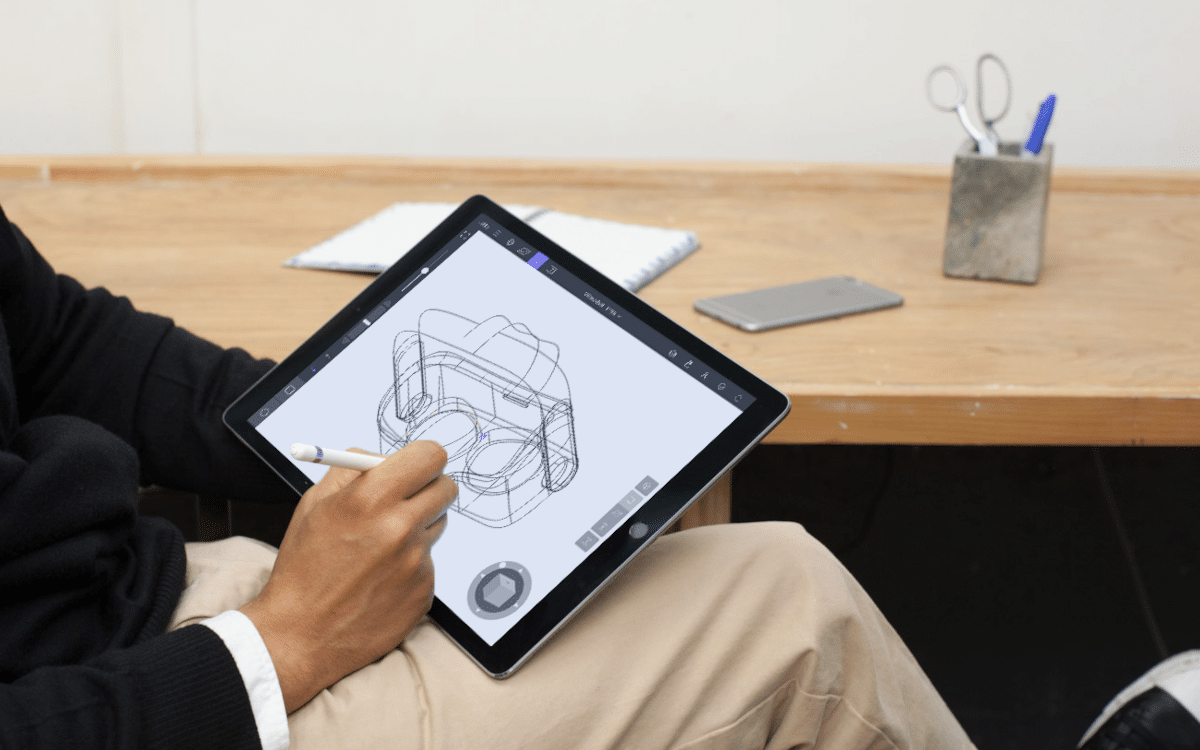 A man sketching on an iPad using Gravity Sketch