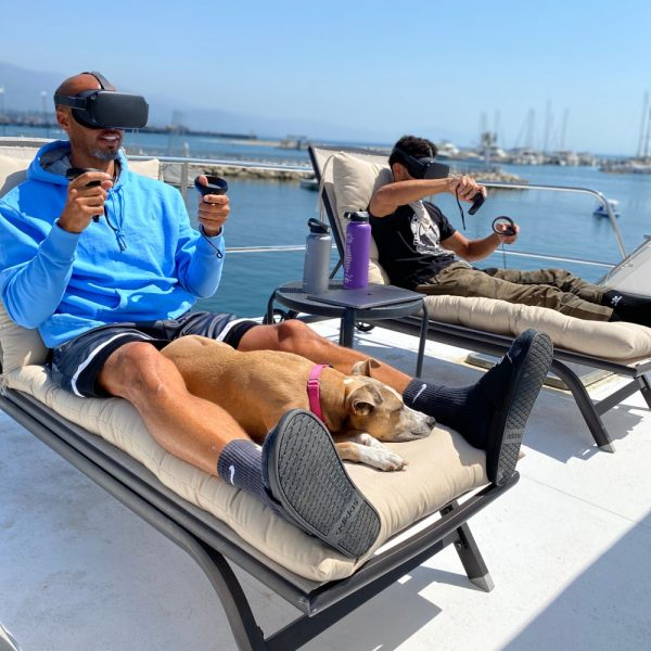 Two men on a boat using VR headsets to design using Gravity Sketch